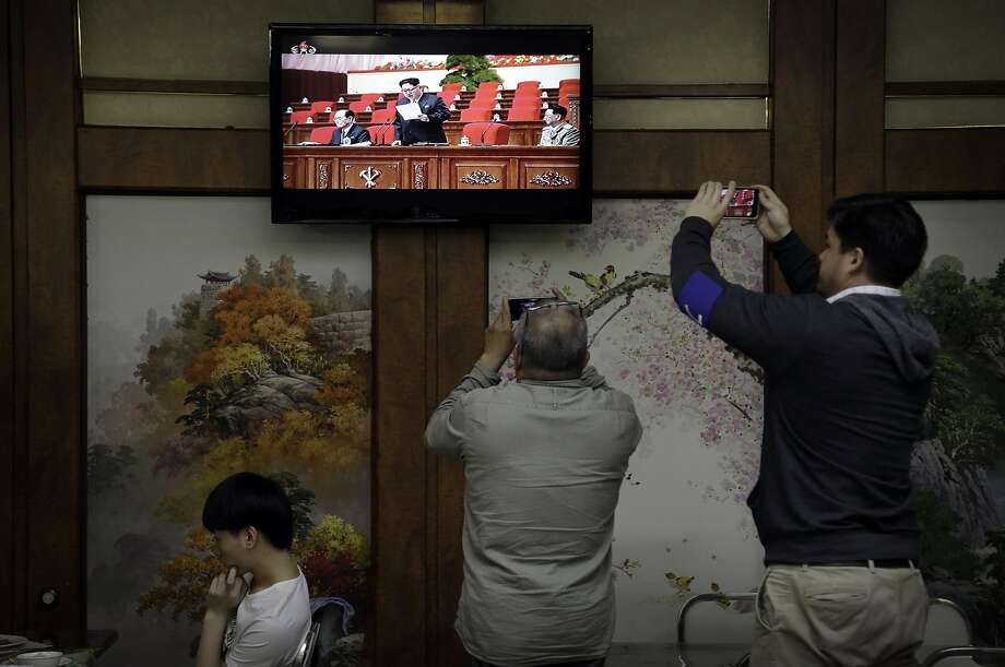 Restaurant diners watch a broadcast of the Seventh Congress of the Workers' Party of Korea on television, where North Korean leader Kim Jong Un is seen delivering a speech in Pyongyang. Photo: Wong Maye-E, Associated Press