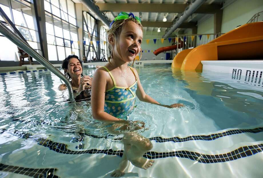 4 year-old Harriet Wiley and her mom Meghan enjoy the Hamilton Recreation Center's indoor pool during open swim. Photo: Michael Macor, The Chronicle