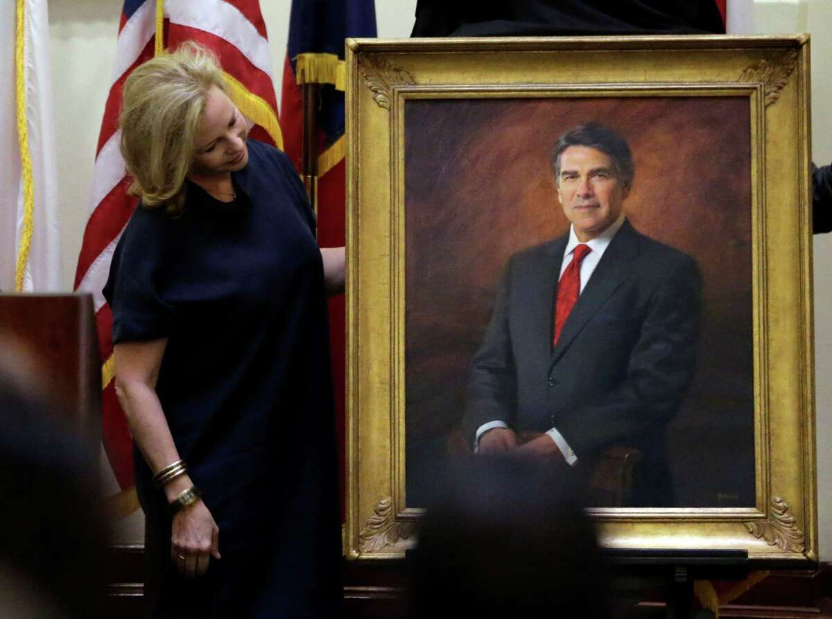 Anita Perry helps with the unveiling of a portrait during a ceremony for her husband, former Texas Gov. Rick Perry, in the Capitol rotunda on Friday, May 6, 2016, in Austin, Texas.