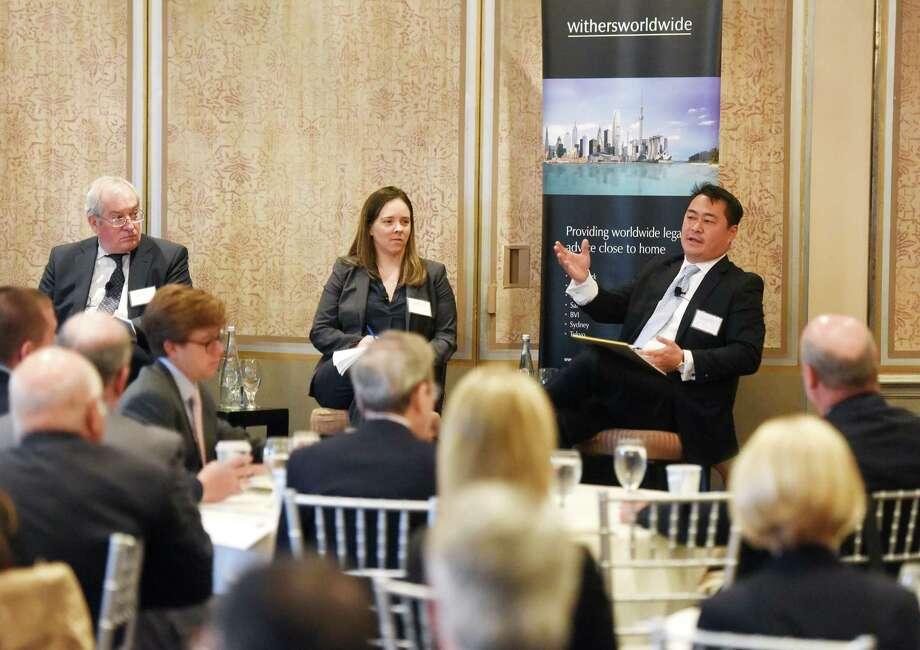 A trio of attorneys from Withers Bergman LLP including, from left, partner James R. Brockway, associate Marissa Dungey, and partner Todd Angkatavanich speak during a panel discussion  at Delamar Greenwich Harbor in Greenwich, Conn. Thursday, May 5, 2016. The panel included Withers Bergman LLP Partner Todd Angkatavanich, Partner James R. Brockway, Associate Marissa Dungey and was moderated by Fairfield County's Community Foundation President and CEO Juanita T. James. The grace period is fast approaching for 2008's Emergency Economic Stabilization Act, which effectively eliminated the ability to defer management fees and carried interests in offshore funds organized in low tax jurisdictions. Photo: Tyler Sizemore / Hearst Connecticut Media / Greenwich Time