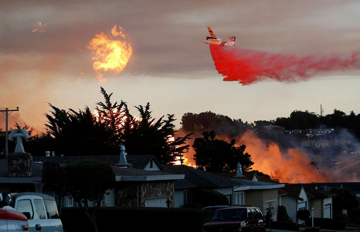 FILE - In this Sept. 9, 2010, file photo, a massive fire following a pipeline explosion roars through a mostly residential neighborhood in San Bruno, Calif. Repeated natural-gas accidents including a pipeline explosion that killed eight people suggest that Pacific Gas & Electric Co., California's largest power utility, may be too big to operate safely, the state's top utility regulator says. California Public Utilities Commission President Michael Picker said he would ask the commission's staff to study