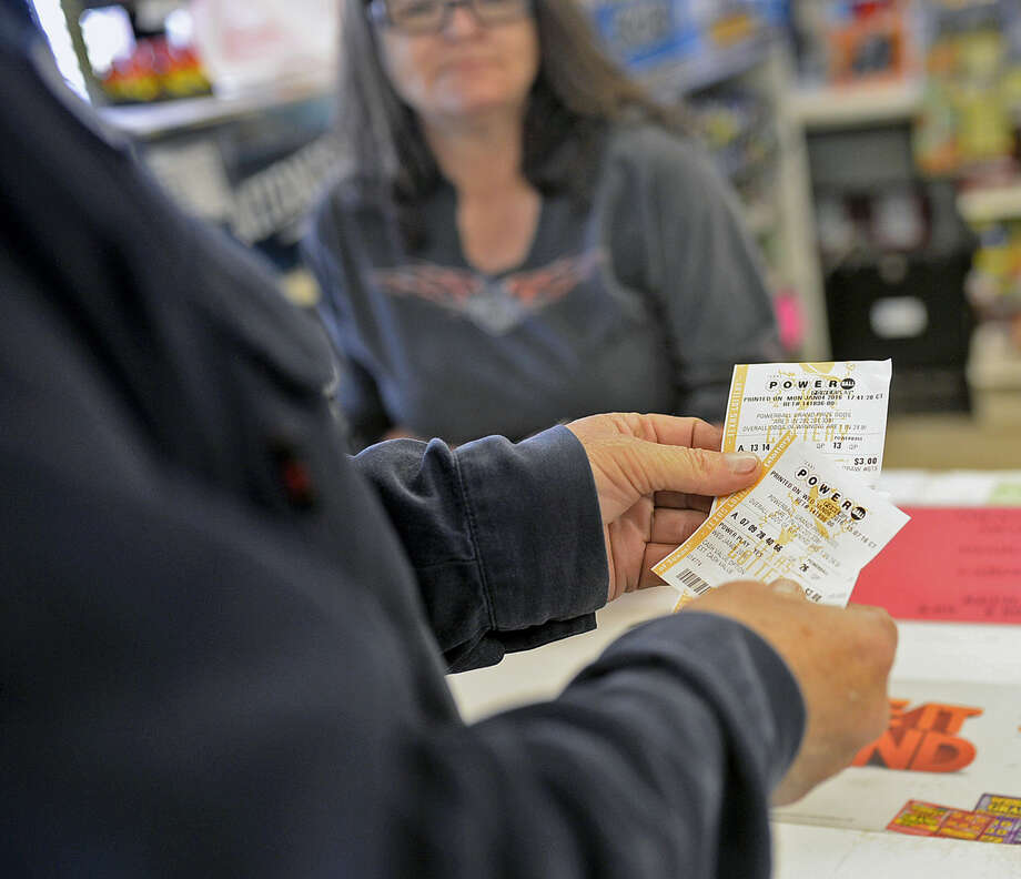 Steve Hildebrand buys two Powerball tickets from Spike's Corner convenience store on Garden City Highway, Wednesday, Jan. 6, 2016. Hildebrand says he has been using the same numbers to pick his lottery tickets for more than two years. James Durbin/Reporter-Telegram Photo: James Durbin
