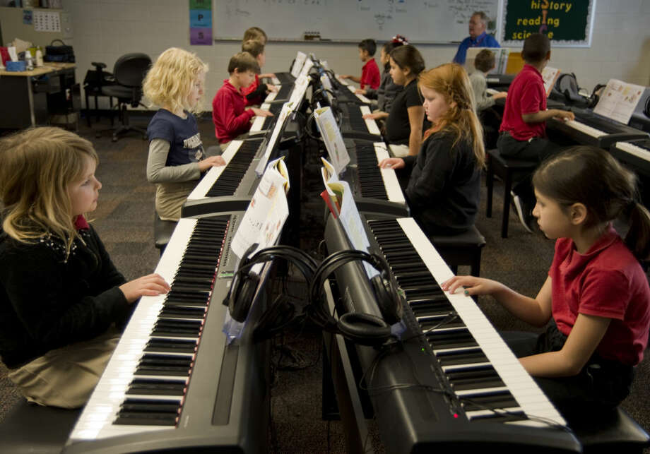 Bowie Fine Arts Academy students work on piano drills Monday 01-04-15 as students and teachers get back into the classroom following winter break. Tim Fischer\Reporter-Telegram Photo: Tim Fischer
