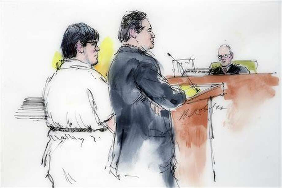 In this courtroom sketch, Enrique Marquez, left, appears with his defense attorney Young Kim in federal court in Riverside, Calif., Monday, Dec. 21, 2015. Marquez, 24, who authorities say bought the assault rifles his friend used in the San Bernardino massacre appeared in court Monday to face terrorism-related allegations. (AP Photo/Bill Robles) Photo: Bill Robles