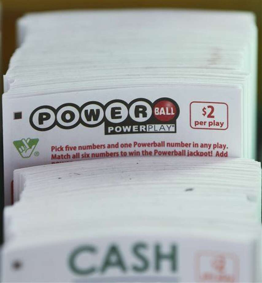 Powerball play slips are stacked up in a store in Richmond, Va., Tuesday, Jan. 5, 2016. Players will have a chance Wednesday night at the biggest lottery prize in nearly a year. The last time Powerball had grown this large was in February 2015, when three winners split a $564.1 million prize. (AP Photo/Steve Helber) Photo: Steve Helber