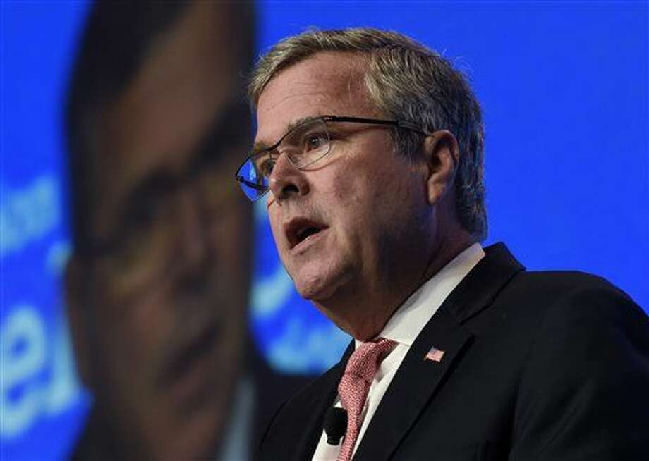 FILE - In this Nov. 20, 2014 file photo, former Florida Gov. Jeb Bush speaks in Washington. There's a whole year of campaigning, positioning and politicking to go before the next campaign for president kicks off with the Iowa Caucus in early 2016. Here's a look at 10 things to look out for next year that might tell us something about how that campaign to come (which is really already underway) may shake out. (AP Photo/Susan Walsh, File) Photo: Susan Walsh