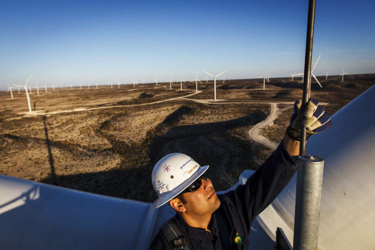 Manny Dominguez, Deputy Facility Manager of the BP Sherbino Mesa II Wind Farm, checks a lighting rod for damage from 285ft atop turbine 53, BP's 1000th wind turbine, Monday, Feb. 20, 2012, in Fort Stockton. After cutting its solar program last year, BP is beefing up its investments into wind energy and recently launched its fourth Texas wind farm, in Fort Stockton. On 20,000 acres in Pecos County, the Sherbino II farm has 60 wind turbines to generate enough electricity to power more than 175,000 homes. ( Michael Paulsen / Houston Chronicle )