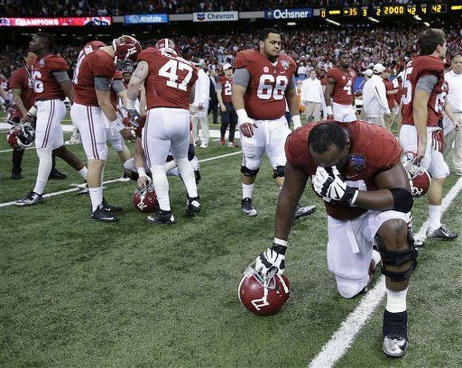 Alabama players take the field after the Sugar Bowl NCAA college football playoff semifinal game against Ohio State, Thursday, Jan. 1, 2015, in New Orleans. Ohio State won 42-35. (AP Photo/Brynn Anderson) Photo: Brynn Anderson