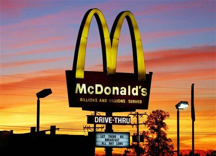 FILE - In this Saturday, Oct. 10, 2015 file photo, the sun sets behind a McDonald's restaurant in Ebensburg, Pa. On Tuesday, Jan. 12, 2016 the European Union said it will analyze an antitrust complaint targeted at the McDonald's which accuses the fast food giant of abusing its dominant position by at the expense of both its franchisees and consumers. The complaint comes on top of last month's opening of an EU investigation whether McDonald's received a sweet tax deal from Luxembourg. (AP Photo/Gene J. Puskar, File) Photo: Gene J. Puskar