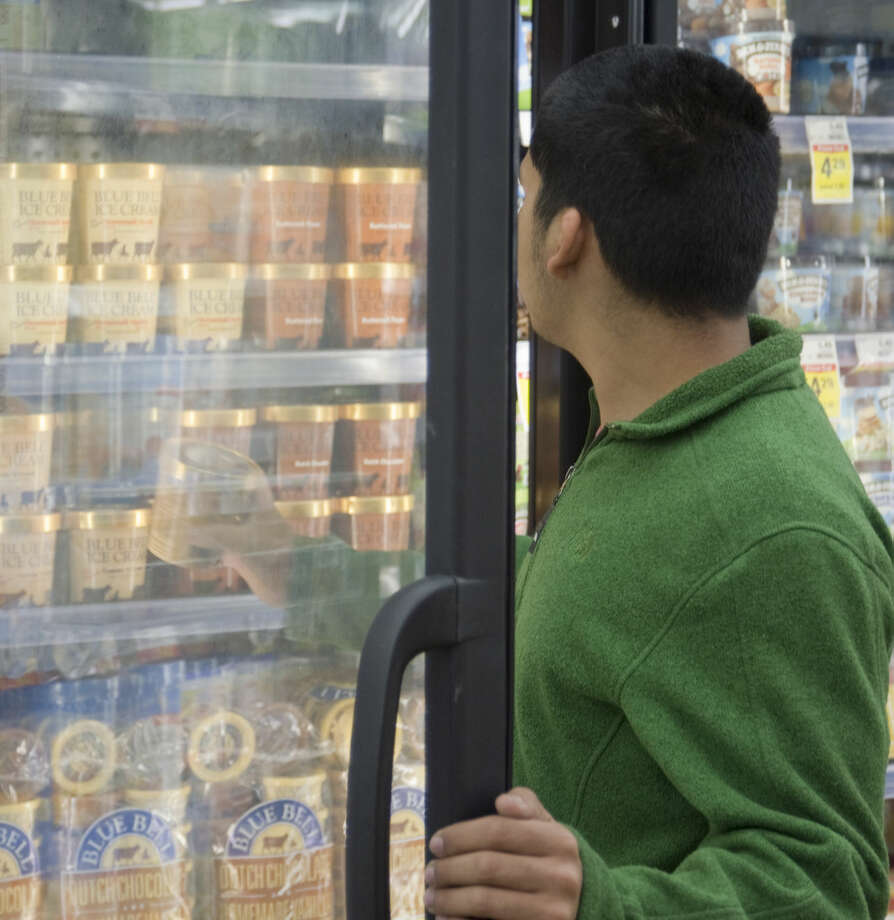 George Ceniceros picks out a pint of Blue Bell Monday 12-14-2015 to take to work after the ice cream was restocked in Midland early Monday morning at Market Street. Tim Fischer\Reporter-Telegram Photo: Tim Fischer