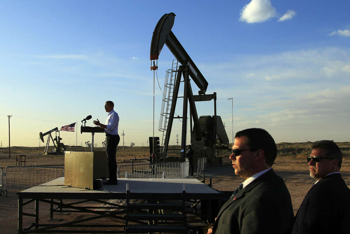 With oil pump jacks as a backdrop, President Barack Obama speaks at an oil and gas field on federal lands Wednesday, March 21, 2012, in Maljamar, N.M.