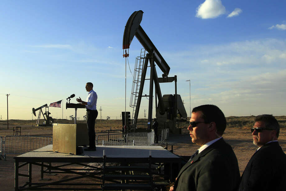 With oil pump jacks as a backdrop, President Barack Obama speaks at an oil and gas field on federal lands Wednesday, March 21, 2012, in Maljamar, N.M. Photo: Ross D. Franklin