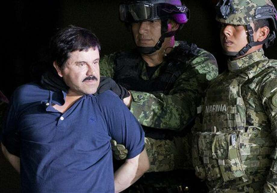 "Joaquin ""El Chapo"" Guzman is made to face the press as he is escorted to a helicopter in handcuffs by Mexican soldiers and marines at a federal hangar in Mexico City, Mexico, Friday, Jan. 8, 2016. Mexican President Enrique Pena Nieto announced that Guzman had been recaptured six months after escaping from a maximum security prison. (AP Photo/Eduardo Verdugo)"