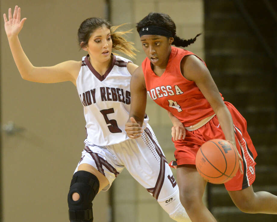 Lee High's Kristyn Velasquez (5) covers Odessa High's Kai'naja Walton (4) on Friday, Jan. 8, 2016 at Chaparral Center. James Durbin/Reporter-Telegram Photo: James Durbin