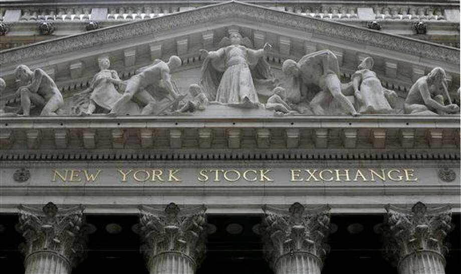 FILE - This Oct. 2, 2014 file photo shows the facade of the New York Stock Exchange. Stock markets mostly fell Friday, Sept. 18, 2015, particularly in Europe, as investors were left in limbo following the Federal Reserve's decision to keep U.S. interest rates unchanged at a record low. (AP Photo/Richard Drew, File) Photo: Richard Drew