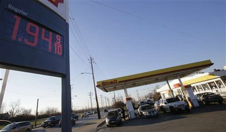 In this Dec. 31, 2014 photo, a price of $1.94 per gallon for regular gas is advertised at a gas station in Cleveland. The price of oil plunged again Monday, Jan. 5, 2015 and briefly dipped below $50 a barrel for the first time in more than five years as evidence mounted that the world will be oversupplied with oil this year. The U.S. national average price of gasoline fell to $2.20 per gallon, the lowest since May of 2009. (AP Photo/Tony Dejak) Photo: Tony Dejak