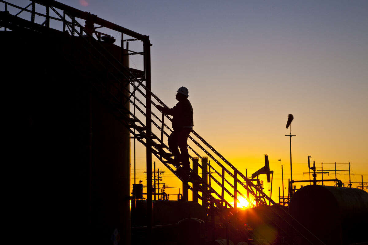 Analysts say falling oil prices are more threat to the balance sheets of smaller companies than large independents like Houston's Apache Corp., which operates this production site near the Adair San Andres field in the Permian Basin of West Texas. Apache Corporation, Brent Briscoe with crude processing equipment at central tank farm Adair San Andreas Unit, Welch, TX.