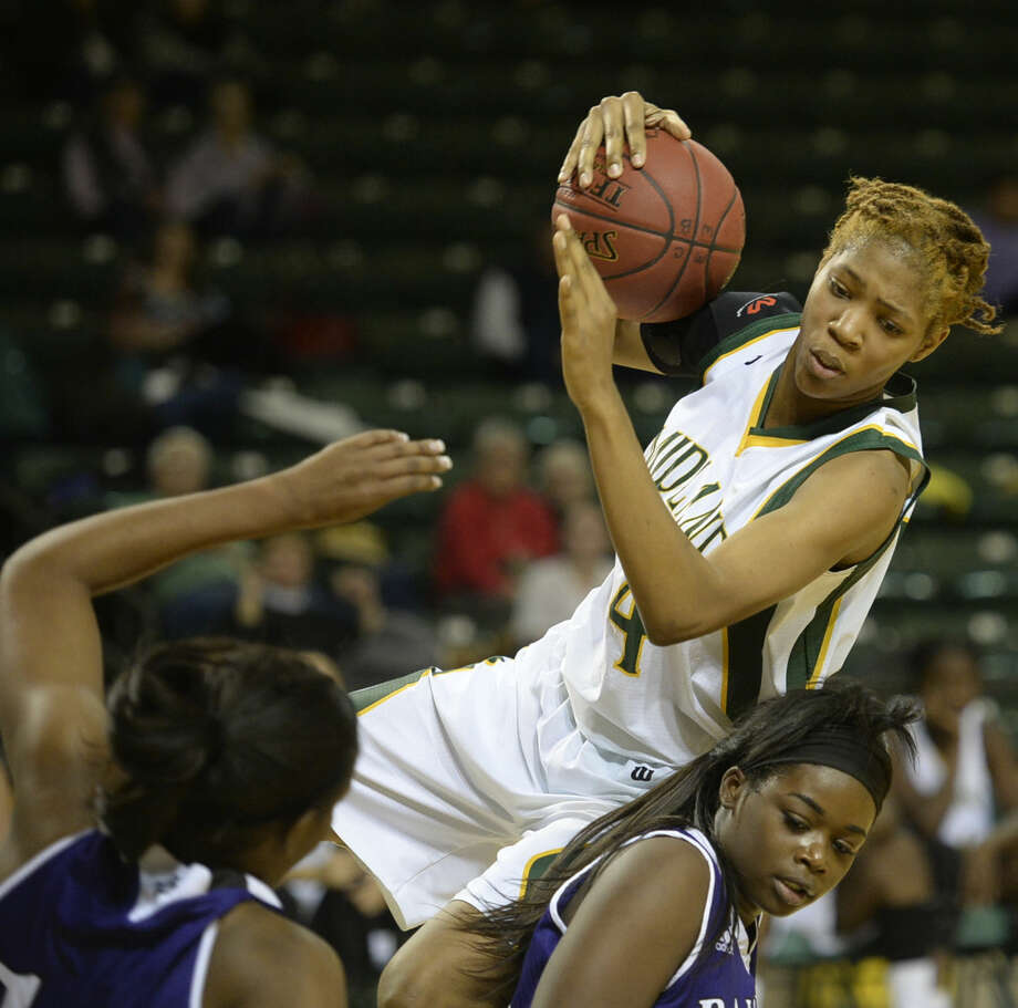 Midland College's Walnatia Wright (24) comes down with a rebound against Ranger College on Wednesday, Jan. 6, 2016 at Chaparral Center. James Durbin/Reporter-Telegram Photo: James Durbin