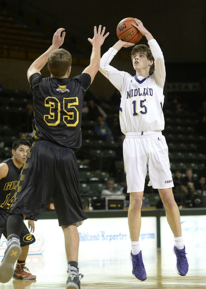 Midland High's Andrew Norwood (15) shoots over Grady on Friday, Jan. 8, 2016, at Chaparral Center. James Durbin/Reporter-Telegram Photo: James Durbin