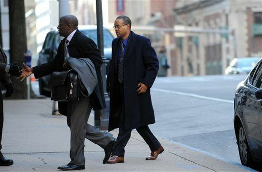FILE - In a Wednesday, Jan. 6, 2016 file photo, Caesar Goodson, right, arrives at Courthouse East, in Baltimore for a motions hearing ahead of the trial for Goodson, who drove the police transport van where Freddie Gray was critically injured. Prosecutors want William Porter, whose trial ended in a mistrial last month, to testify against Goodson and Sgt. Alicia White. (Kim Hairston/The Baltimore Sun via AP, File) WASHINGTON EXAMINER OUT; MANDATORY CREDIT Photo: Kim Hairston