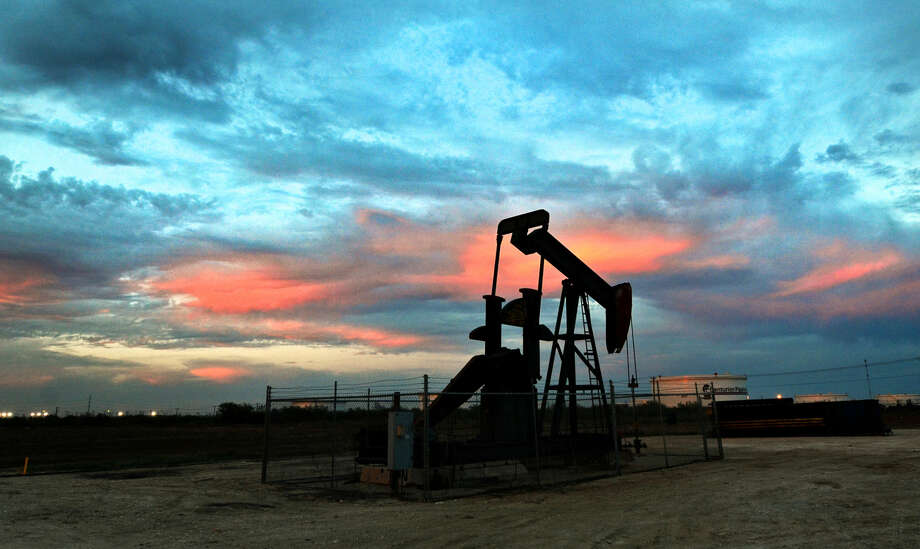 Pumpjack at sunset Thursday in Midland. James Durbin/Reporter-Telegram