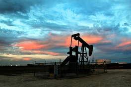 Pumpjack at sunset Thursday in Midland. James Durbin/Reporter-Telegram