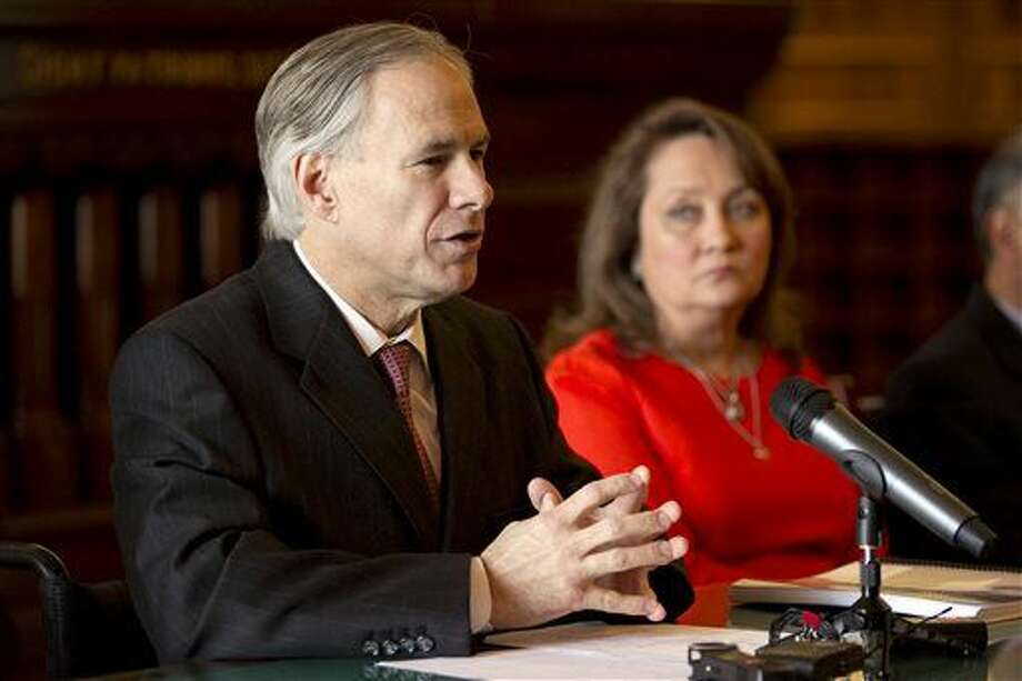 Texas Gov.-elect Greg Abbott Greg Abbott announces key staff positions and outlines his priorities for the upcoming legislative session during a news conference at the Capitol in Austin, Texas, Monday, Dec. 8 2014. At Abbott's side is his wife, Cecilia. (AP Photo/Austin American-Statesman, Deborah Cannon) Photo: Dborah Cannon