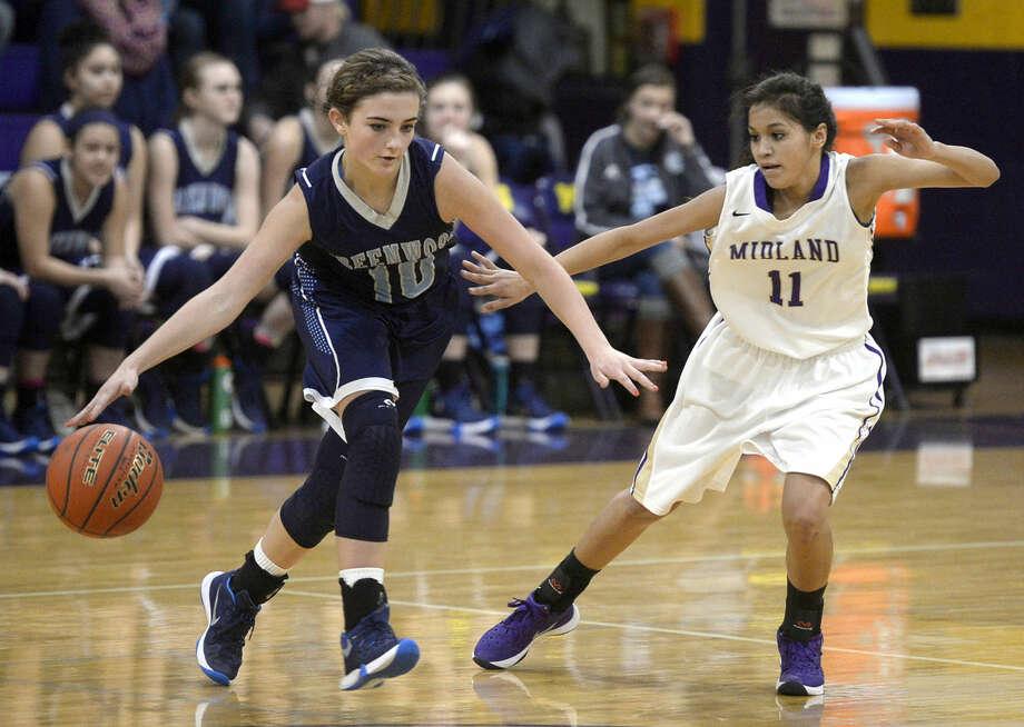 Midland's Amber Salcido (11) covers Greenwood's Caity Payne (10) on Wednesday, Dec. 30, 2015, at Midland High. James Durbin/Reporter-Telegram Photo: James Durbin