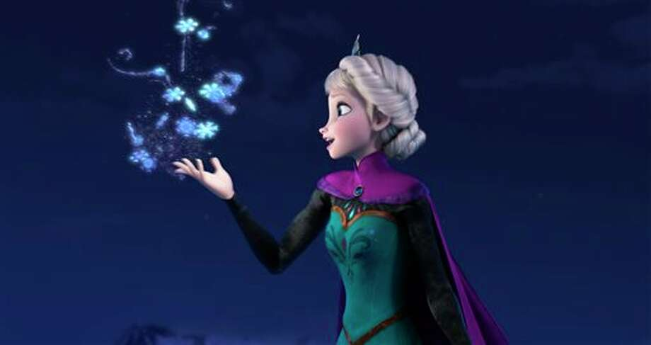 "FILE - This file image provided by Disney shows Elsa the Snow Queen, voiced by Idina Menzel, in a scene from the animated feature ""Frozen."" According to studio estimates Sunday, Jan. 5, 2014, Disney's ""Frozen"" remained atop the box office with $20.7 million, freezing out the horror spinoff ""Paranormal Activity: The Marked Ones."" (AP Photo/Disney, File) Photo: Daram / Disney"