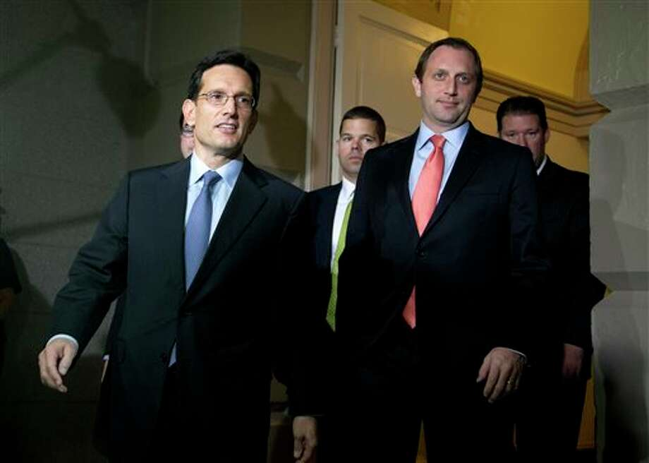 FILE - In this Oct. 16, 2013 file photo House Majority Leader Eric Cantor of Va., left, arrives for a meeting with House Republicans on Capitol Hill in Washington. Congress returns to work on Jan. 6, 2014, with election-year politics certain to shape an already limited agenda. (AP Photo/Carolyn Kaster, File) Photo: Carolyn Kaster / AP