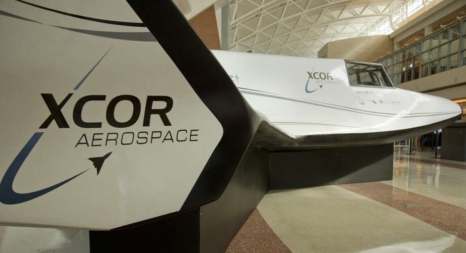 Chinese journalists get a tour Friday 8-21-2015 and information on XCOR and the planned flights out of Midland Air & Space Port and a closeup look of the Lynx madel on display in the airport terminal. Tim Fischer\Reporter-Telegram Photo: Tim Fischer\Reporter-Telegram