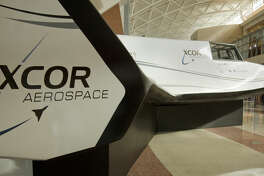 Chinese journalists get a tour Friday 8-21-2015 and information on XCOR and the planned flights out of Midland Air & Space Port and a closeup look of the Lynx madel on display in the airport terminal. Tim Fischer\Reporter-Telegram