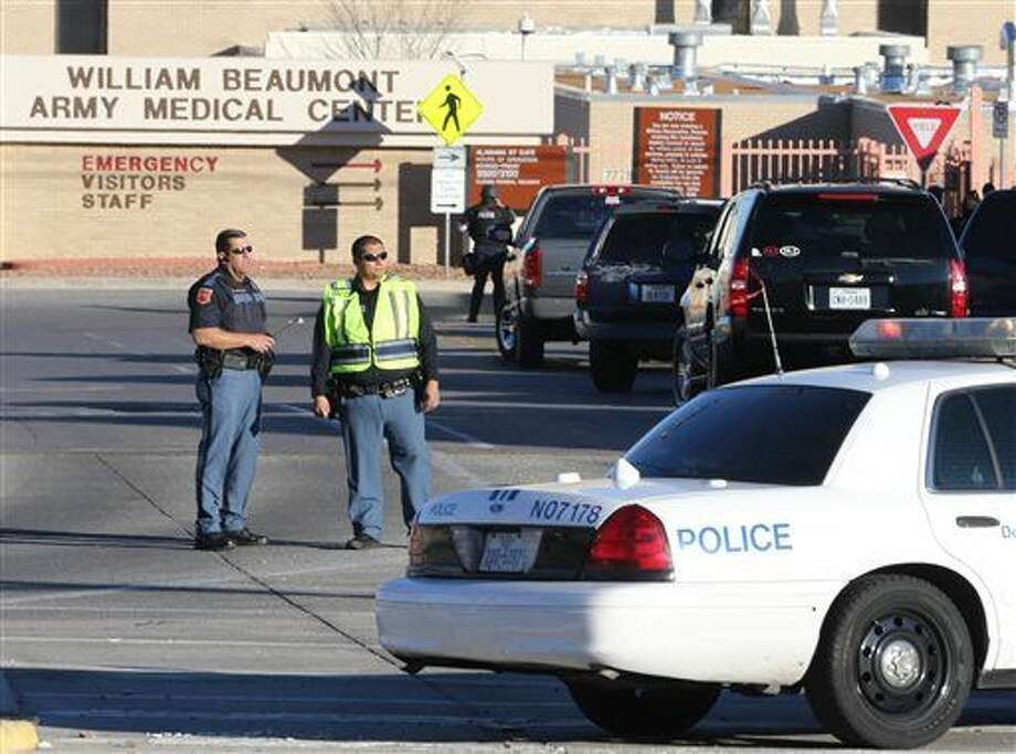 CORRECTS YEAR - Police officers guard an entrance to the Beaumont Army Medical Center/El Paso VA campus during the search for a gunman Tuesday, Jan. 6, 2015. (AP Photo/The El Paso Times, Victor Calzada) Photo: Victor Calzada