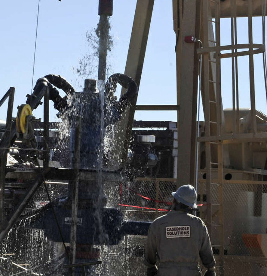 Water gushes out of a drilling pipe as it is pulled up to be replaced with a fresh pipe at a hydraulic fracturing site in Midland, Texas, Sept. 24, 2013. The drilling method known as fracturing uses huge amounts of high-pressure, chemical-laced water to free oil and natural gas trapped deep in underground rocks. With fresh water not as plentiful companies have been looking for ways to recycle their waste. (AP Photo/Pat Sullivan)