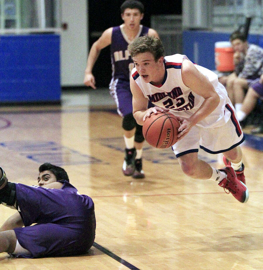 Midland Christian's Grant Little (23) drives to the hoop after getting a steal against Alpine on Tuesday, Jan. 6, 2014 at McGraw Event Center. James Durbin/Reporter-Telegram Photo: James Durbin