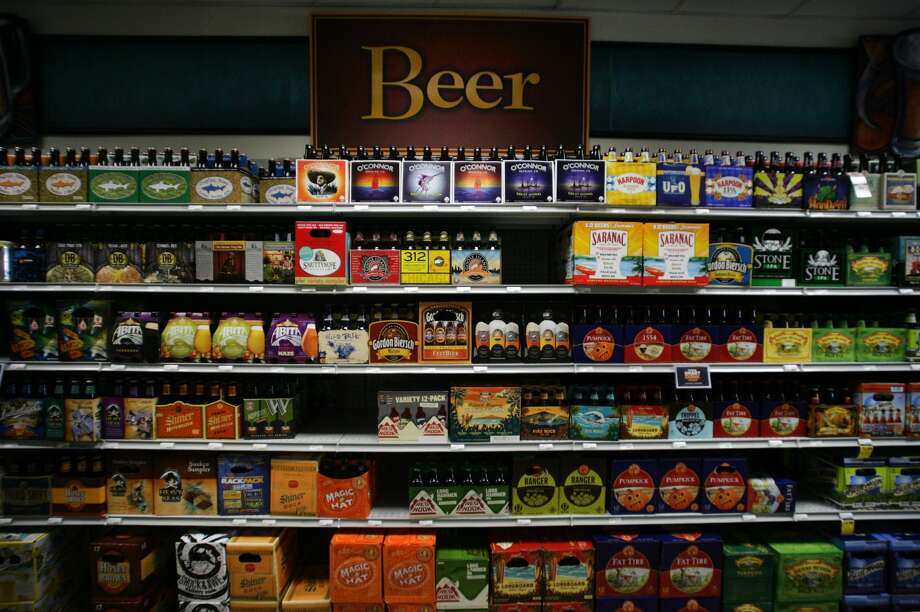 FILE - In this July 31, 2013 photo, beer is displayed for sale in Norfolk, Va.  Photo: Jason Hirschfeld