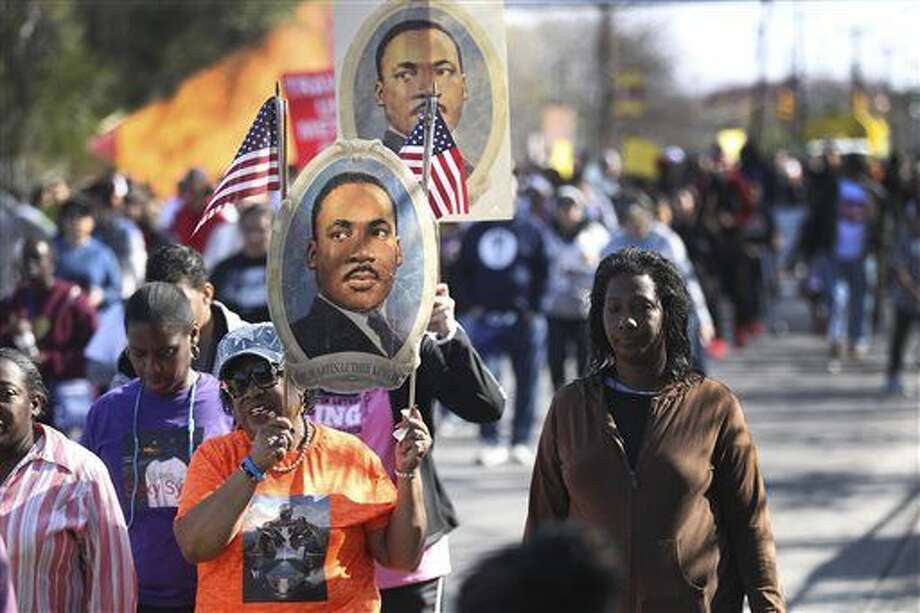 People march Monday Jan. 18, 2016, for the Martin Luther King, Jr. March in San Antonio, Texas. Marches, speeches and concerts were part of celebrations across Texas to remember slain civil rights leader Martin Luther King Jr. on the federal holiday. (John Davenport/The San Antonio Express-News via AP) RUMBO DE SAN ANTONIO OUT; NO SALES; MANDATORY CREDIT Photo: John Davenport