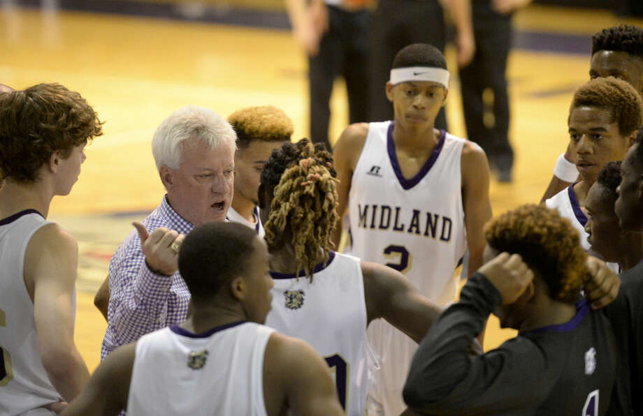 Midland boys basketball head coach Shannon Hooker talks to his team during a time out in the game against Tascosa on Tuesday, Nov. 17, 2015, at Midland High. James Durbin/Reporter-Telegram Photo: James Durbin