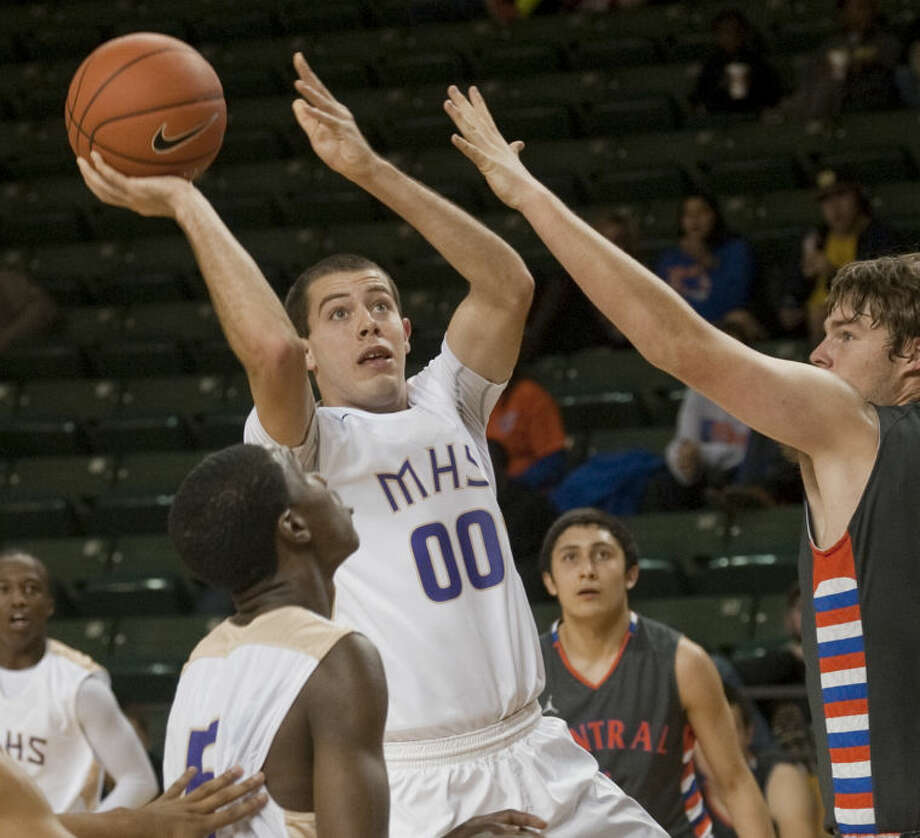 Midland High's Justin LeClear puts a shot up as San Angelo Central's Brock Burger defends Thursday evening at Chaparral Center. Tim Fischer\Reporter-Telegram Photo: Tim Fischer