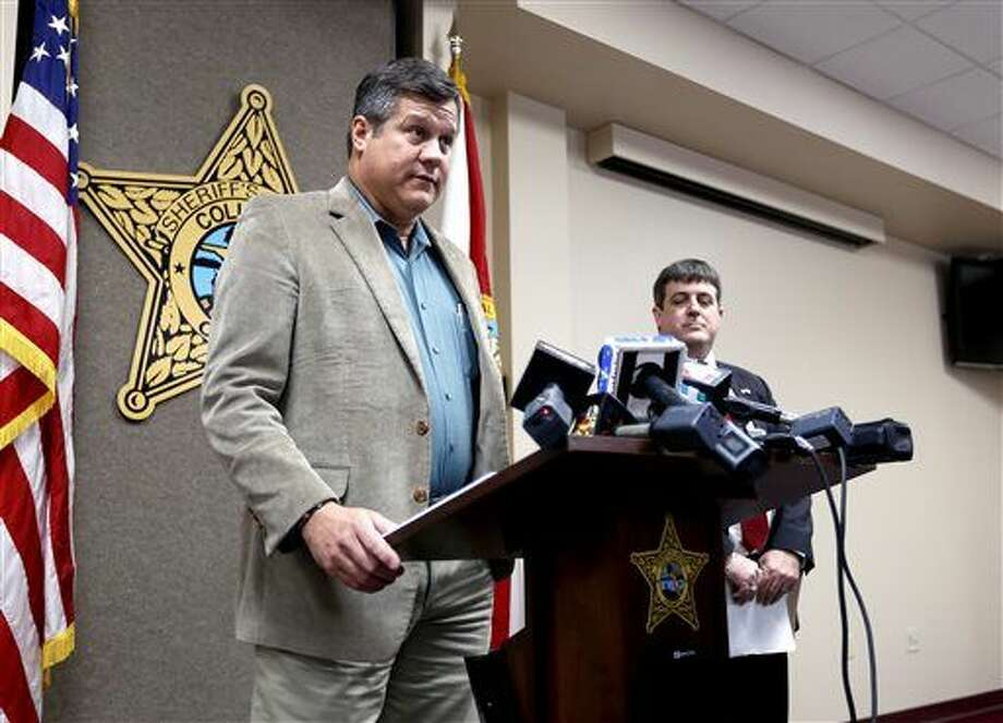 Columbia County Sheriff Mark Hunter speaks during a news conference on Wednesday, Jan. 7, 2015 in Lake City, Fla. about two Columbia County girls accused of killing their brother. Columbia County State Attorney Jeff Seigmeister, right, also spoke. (AP Photo/Matt Stamey, The Gainesville Sun) Photo: Matt Stamey