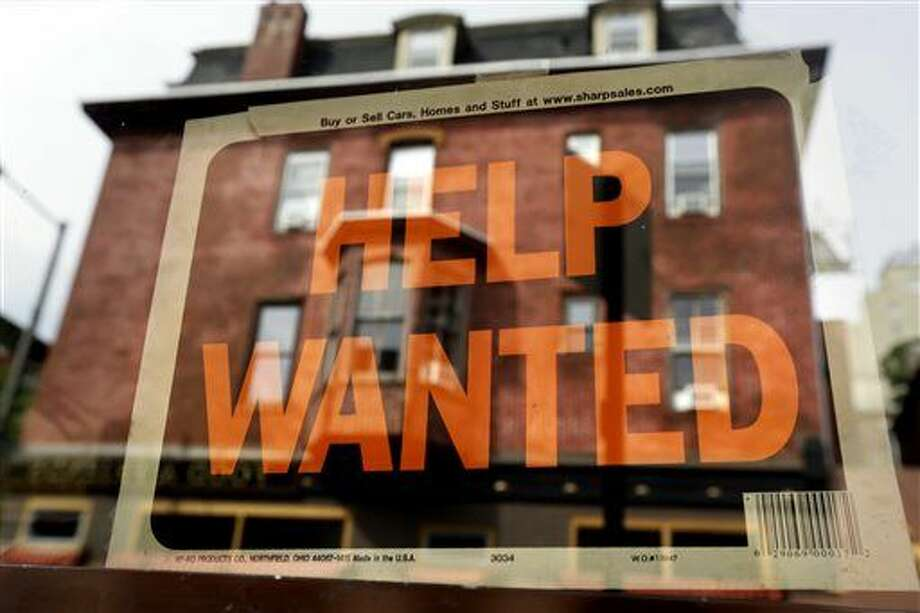 FILE - In this Aug. 19, 2013 file photo, a Philadelphia business displays a help wanted sign in its storefront. With the price of oil below $50 a barrel, consumers will have steadily more money to spend, potentially creating job openings at retailers, auto dealers, shipping firms, restaurants and hotels. (AP Photo/Matt Rourke, File) Photo: Matt Rourke