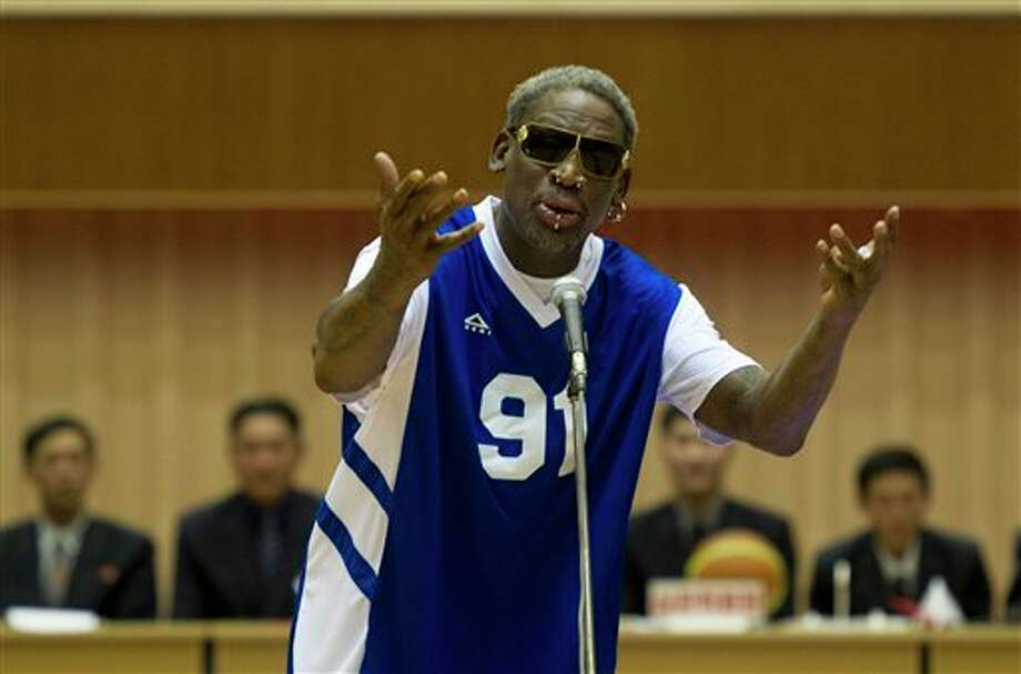 Dennis Rodman sings Happy Birthday to North Korean leader Kim Jong Un, seated above in the stands, before an exhibition basketball game at an indoor stadium in Pyongyang, North Korea on Wednesday, Jan. 8, 2014. (AP Photo/Kim Kwang Hyon) Photo: Kim Kwang Hyon / AP