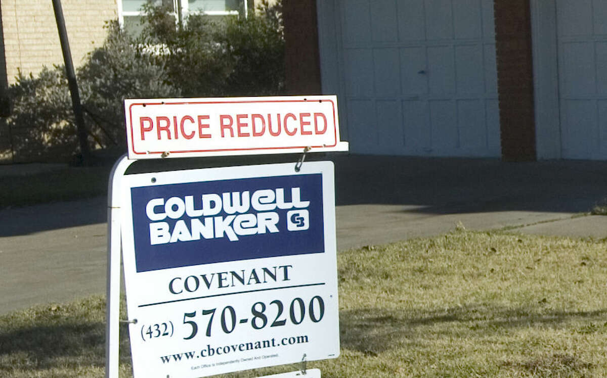 Home for sale in Midland with Price Reduced sign.