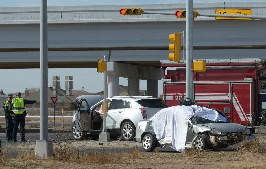 Odessa Police investigate a three-vehicle collision Tuesday afternoon at Faudree Road and the south Highway 191 service road in which one person died and two others were transported to Medical Center Hospital. Photo: Mark Sterkel|Odessa American