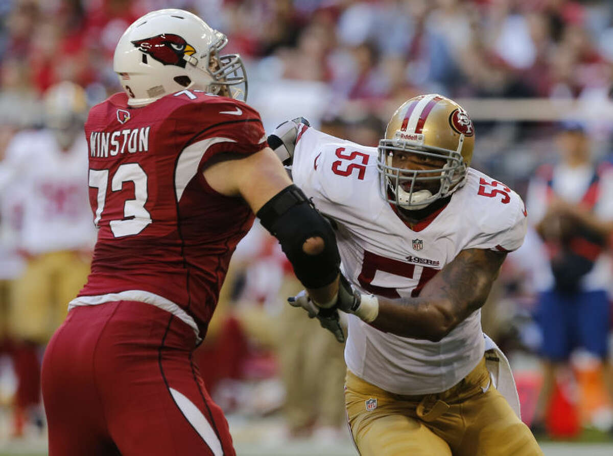 Arizona Cardinals tackle Eric Winston (73) and San Francisco 49ers outside linebacker Ahmad Brooks (55) battle during the first half of an NFL game Sunday, Dec. 29, 2013, in Glendale, Ariz. (AP Photo/Rick Scuteri)