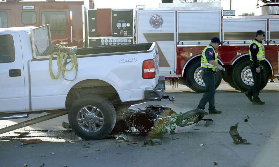 Midland public safety personnel work the scene of a fatal wreck involving a motorcyclist who evaded a police traffic stop before crashing into a pickup truck near the intersection of Lamesa Rd and Garden Lane. James Durbin/Reporter-Telegram Photo: James Durbin