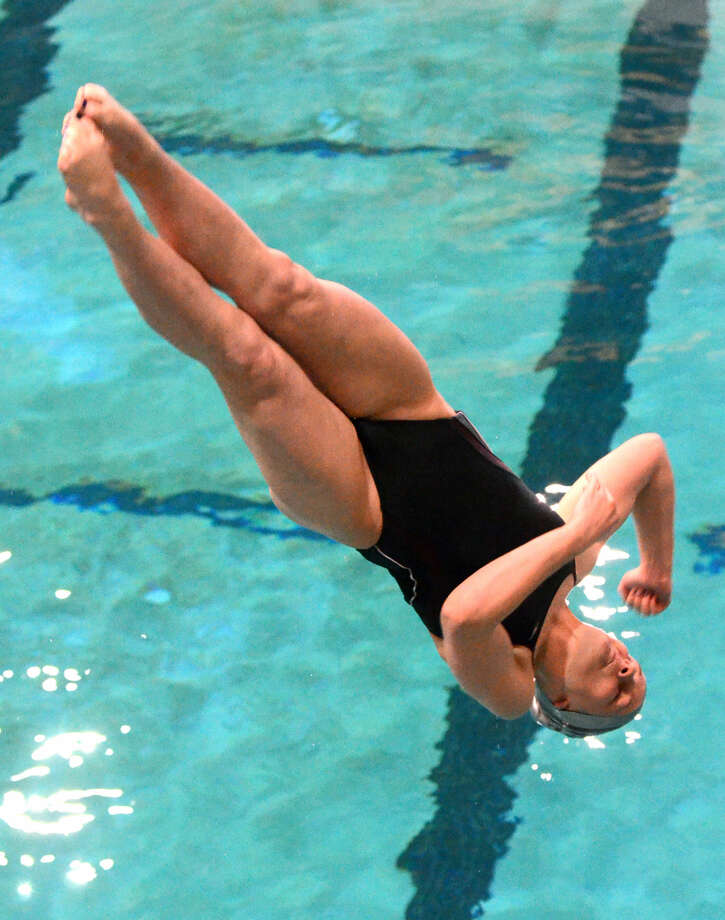 Lee High's Charlye Campbell competes in the women's 1 meter dive during the District 3-6A swimming and diving championships Saturday, Jan. 24, 2015 at the Mabee Aquatic Center. James Durbin/Reporter-Telegram