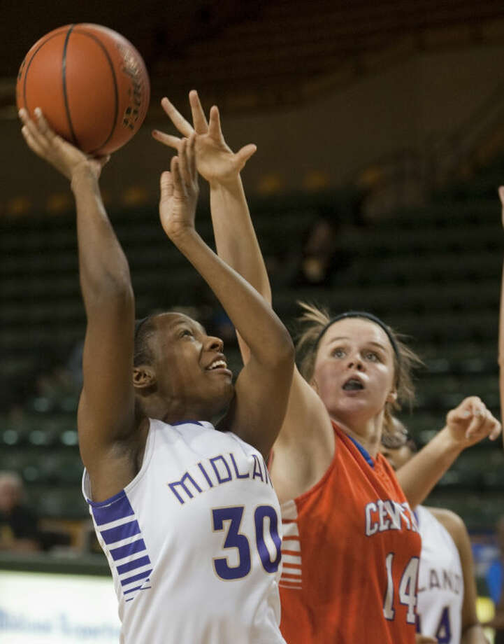 Midland High's Desare' Allen puts up a shot over San Angelo Central's Cali Barger in early January at the Chaparral Center. Tim Fischer\Reporter-Telegram Photo: Tim Fischer
