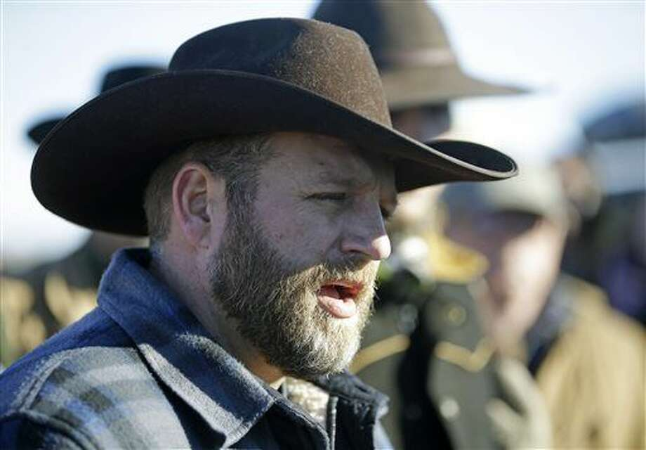 Ammon Bundy speaks with reporter at a news conference at Malheur National Wildlife Refuge Friday, Jan. 8, 2016, near Burns, Ore. Bundy, the leader of an armed group occupying the national wildlife refuge to protest federal land management policies, said Friday he and his followers are not ready to leave even though the sheriff and many locals say the group has overstayed their welcome. (AP Photo/Rick Bowmer) Photo: Rick Bowmer