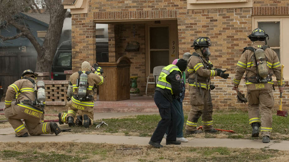Midland firefighters respond to a house fire Friday, 01-09-15, in the 900 block of W. Michigan. One person was transported to MMH with unknown injuries. Tim Fischer\Reporter-Telegram Photo: Tim Fischer